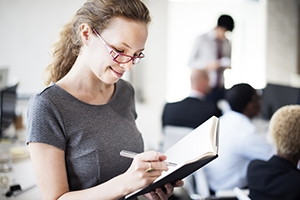 Business Woman Secretary Writing Information Concept